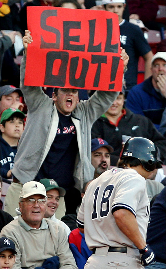 Damon jogged back to the dugout past a sign.