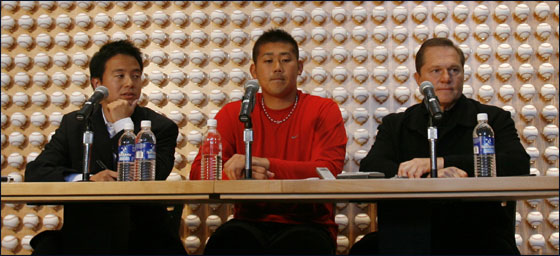 Daisuke Matsuzaka of Japan, center, holds a press conference at the office of his agent, Scott Boras, right, in Newport Beach, Calif., Wednesday, Jan. 31, 2007. At left is interpreter Masa Hoshino