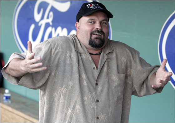 Red Sox pitcher David Wells shrugs his shoulders in the dugout in Fort Myers, Fla., Sunday, March 5, 2006.