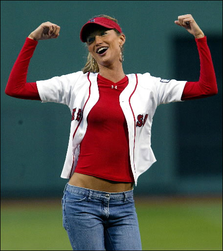 Supermodel Gisele threw out a ceremonial first pitch prior to the Red Sox-Oakland Athletics game at Fenway Park, and after the ball sailed way over the head of the catcher, she flexed her muscles in jest.