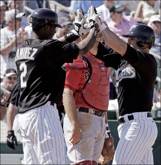 Florida Marlins' Hanley Ramirez (No. 2) celebrates with Dan Uggla at the plate following Uggla's two run homer that scored Ramirez in the fifth inning of their spring training baseball game in Jupiter, Fla. Wednesday, March 8, 2006.