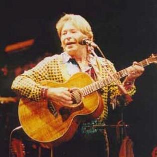 John Denver performing