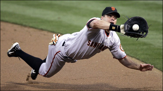 First baseman J.T. Snow of the San Francisco Giants tries to catch a line drive hit by Xavier Nady of the San Diego Padres in the first inning on July 1, 2005 at PETCO Park in San Diego.
