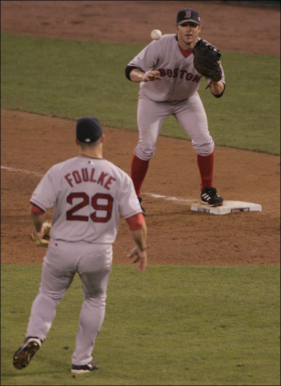 10/27/04--ST. LOUIS--Red Sox reliever Foulke tosses a fielded ball to first baseman Doug Mientkiewicz to make the final out of the game as the Boston Red Sox defeated the St. Louis Cardinals in game 4 to win the 2004 World Series played at Busch Stadium in St. Louis
