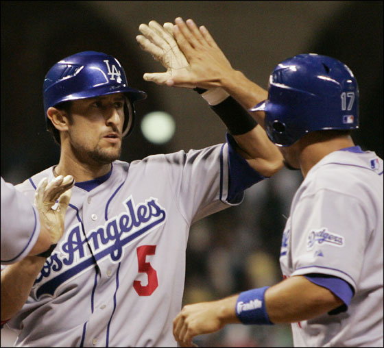 Los Angeles Dodgers' Nomar Garciaparra is congratulated by teammates Jeff Kent, and Jason Repko after hitting a grand slam against the Houston Astros during the ninth inning of their Major League Baseball game Monday, April 24, 2006, in Houston.