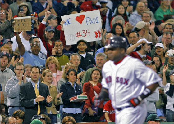 .Red Sox DH David Ortiz is cheered and saluted by  the fans as he heads for home after his third inning solo home run sailed out of the park. Devil Rays' manager Joe Maddon (beneathh Ortiz' left arm) doesn't look thrilled.