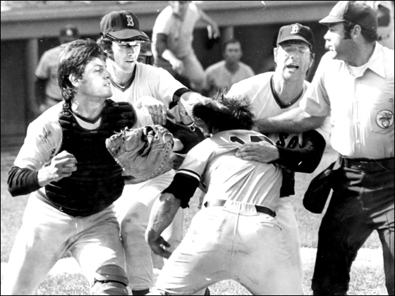 Globe file photo 8/1/1973. Red Sox Carlton Fisk and Yankees Thurmon Munson as they collide at home plate. In back, Red Sox players Doug Griffin and John Curtis attempt to pull Munson away from fight at the plate.