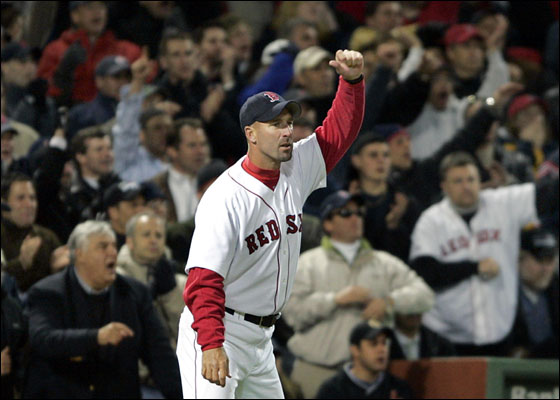 Red Sox third base coach Dale Sveum waves home a runner during a game vs. the Yankees at Fenway Park April 14, 2005.