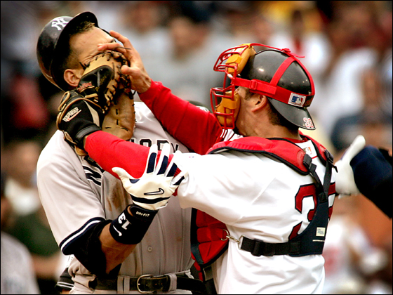 7/24/04: Alex Rodriguez of the Yankees and Red Sox catcher Jason Varitek trade blows in the third inning that precipitated a bench clearing brawl between the two teams. Both players were ejected from the game.