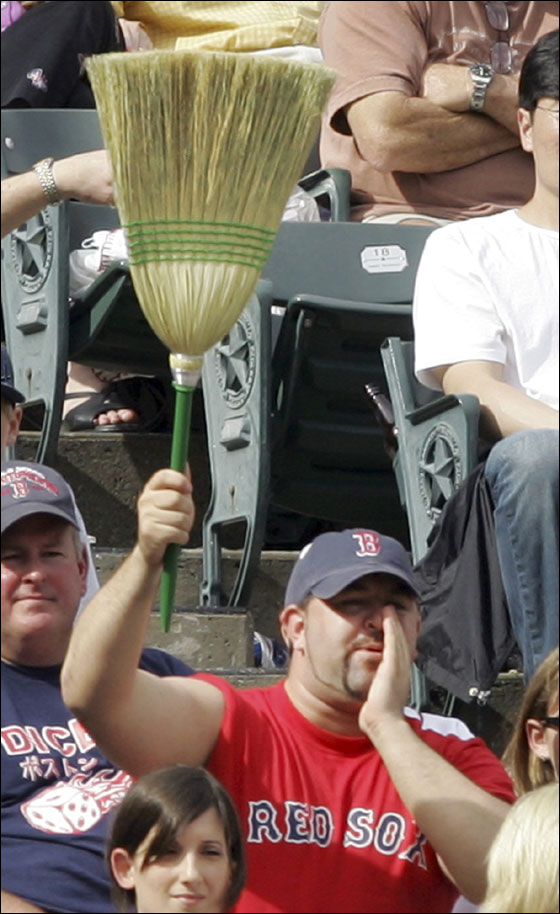 A Boston Red Sox fans holds up a broom in the ninth inning of the baseball game against the Texas Rangers in Arlington,Texas, Sunday, May 27, 2007. The Red Sox completed a three-game sweep over the Rangers with a 6-5 win.