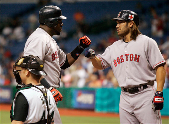 Red Sox's David Ortiz celebrates with teammate Johnny Damon after hitting a two-run homer off of Tampa Bay Devil Rays pitcher Seth McClung during the first inning of their American League game at Tropicana Field in St. Petersburg, Florida