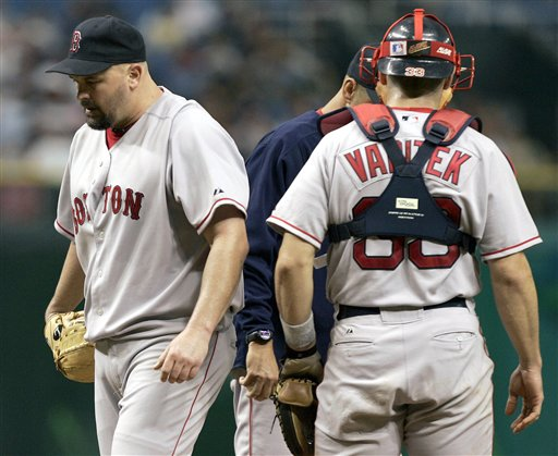 Red Sox pitcher David Wells, left, leaves the mound after being taken out of the game against the Tampa Bay Devil Rays in the third inning Monday night Sept. 19, 2005 in St. Petersburg, Fla. Wells pitched 2 and 2/3 innings, giving up four runs on 10 hits. On the mound is manager Terry Francona and catcher Jason Varitek.