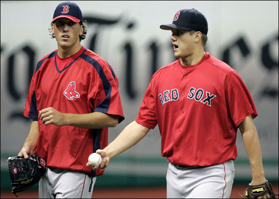 Red Sox 2005 first-round draft pick Craig Hansen, left, walks with pitcher Jonathan Papelbon while the team takes batting practice before their game with the Tampa Bay Devil Rays Monday night in St. Petersburg, Fla.