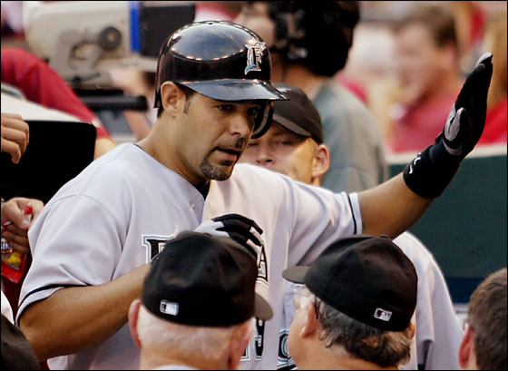 Florida Marlins Mike Lowell is congratulated in the dugout after hitting a two-run home in the second inning against the St. Louis Cardinals at Busch Stadium in St. Louis, Missouri on August 1, 2005