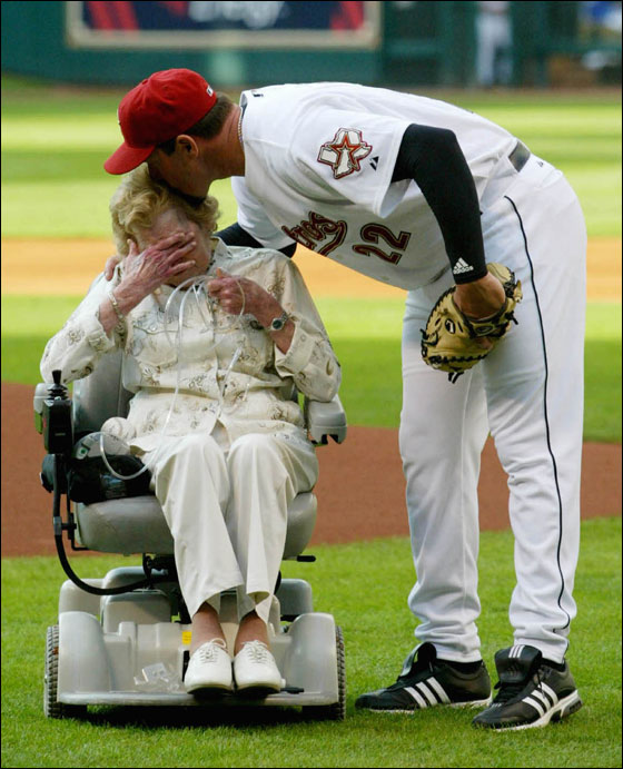 Houston Astros pitcher Roger Clemens kisses his mother Bess on the head as she cries after throwing out the first pitch during pre-game ceremonies  April 9, 2005 in Houston. The 22-year MLB veteran donated his seventh Cy Young trophy to Houston fans to be put on permanent display inside Minute Maid park.