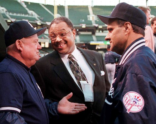 New York Yankees coach Don Zimmer, from left, general manager Bob Watson and manager Joe Torre talk before the start of Game 4 of the American League Championship Series Saturday, Oct. 12, 1996 at Oriole Park at Camden Yards in Baltimore.