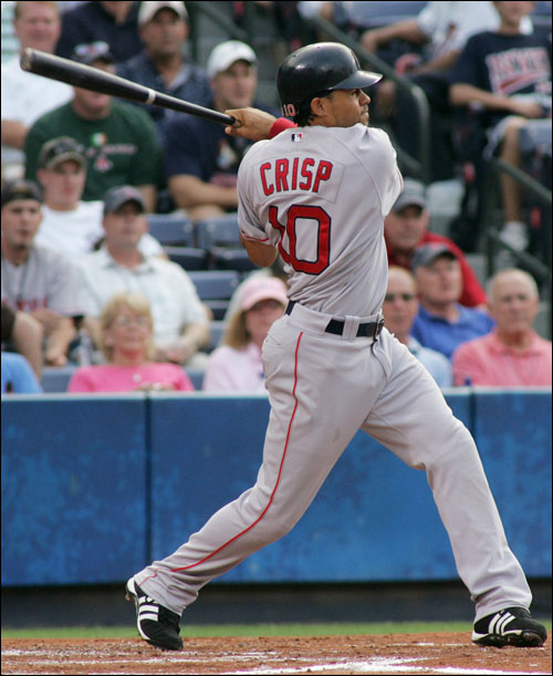 Coco Crisp connects on a solo home run off Atlanta Braves starting pitcher Chuck James in the second inning.
