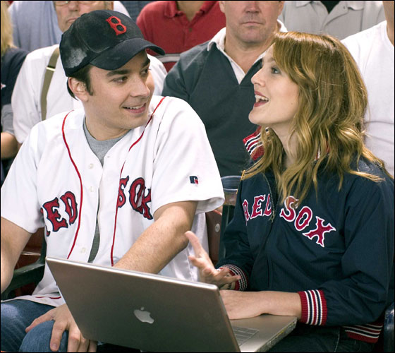 Single Red Sox fans Jimmy Fallon and Drew Barrymore take in a game at Fenway in 2004