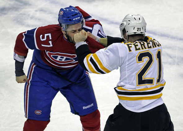 The Bruins Andrew Ference lands a solid left to the face of the Canadiens Benoit Pouliot late in the first period. The Boston Bruins visited the Montreal Canadiens in an NHL Playoff Game held at the Bell Centre.