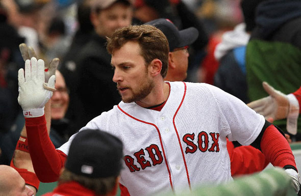 Boston Red Sox shortstop Jed Lowrie (12) was in the lineup batting leadoff and he delivered. Here he is congratulated in the dugout after hitting a 2 run homer in the 2nd inning. Boston Red Sox take on the Toronto Blue Jays
