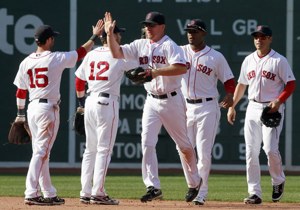 .D. Drew, center, celebrates with teammates, from left, Dustin Pedroia, Jed Lowrie, Carl Crawford and Jacoby Ellsbury after beating the Toronto Blue Jays 8-1 in the ninth inning of a major league baseball game, Sunday, April 17, 2011, in Boston.