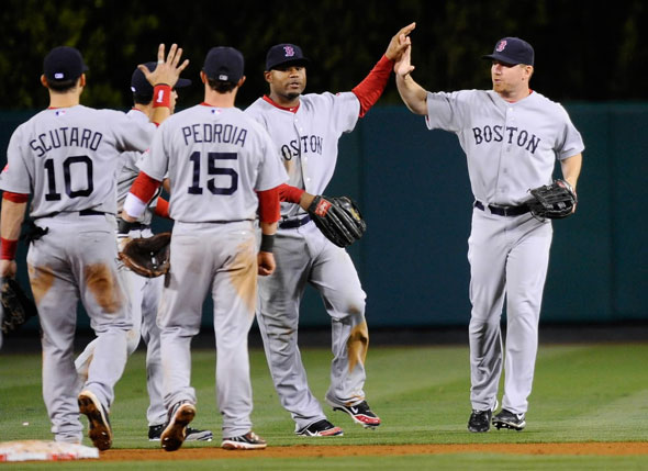 J.D. Drew, Carl Crawford, Dustin Pedroia, Marco Scutaro, and Jacoby Ellsbury of the Boston Red Sox celebrate after defeating the Los Angeles Angels of Anaheim in 11 innings at Angel Stadium of Anaheim on April 21, 2011 in Anaheim, California.