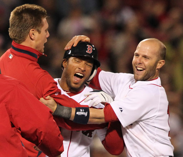 Red Sox Darnell McDonald celebrates with teammates Jonathan Papelbon (left) and Dustin Pedroia after his game winning hit against the Texas Rangers during 9th inning action at Fenway Park on Tuesday April , 20 2010.