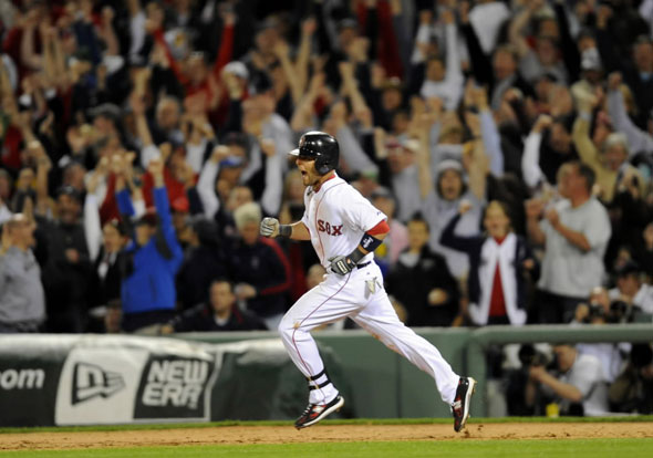Dustin Pedroia reacts after hitting a two-run home run against the New York Yankees during the seventh inning of the first American League baseball game of MLB's 2010 season at Fenway Park in Boston, Massachusetts April 4, 2010.