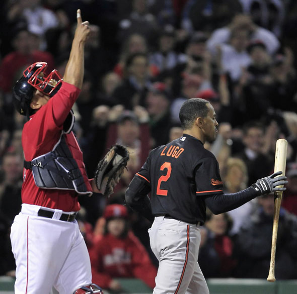 Julio Lugo, right, catches his bat after striking out to end the game as Boston Red Sox catcher Victor Martinez points upward during a baseball game at Fenway Park in Boston, Friday, April 23, 2010.
