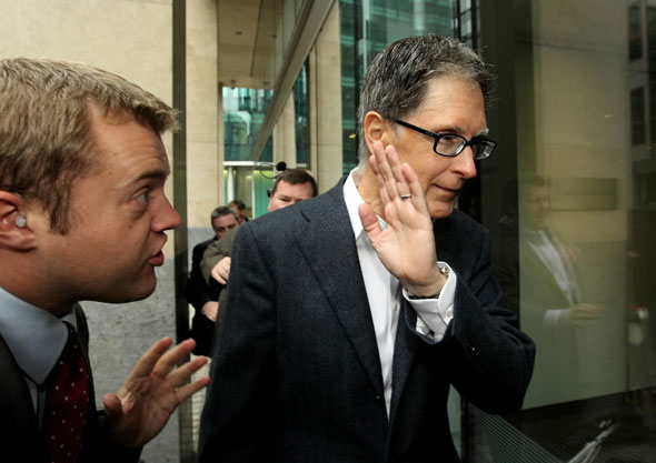 Oct. 15: John W. Henry (R), the owner of New England Sports Ventures, arrives at the offices of the law firm Slaughter and May on October 15, 2010 in London, England.