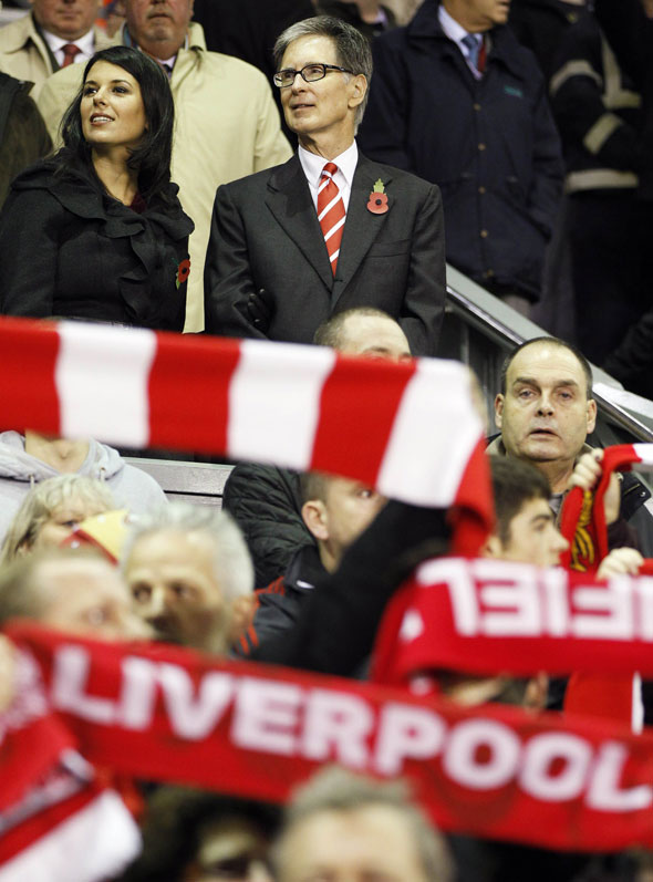 Liverpool co-owner John Henry and his wife Linda Pizzuti take their seats before their UEFA Europa League football match against Naoli at Anfield in Liverpool, north-west England, on November 4, 2010.