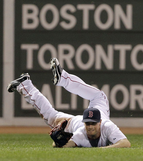Red Sox left fielder Daniel Nava makes a diving catch of a line drive by Los Angeles Angels' Maicier Izturis in the eighth inning of a baseball game at Fenway Park in Boston on Wednesday, Aug. 18, 2010.