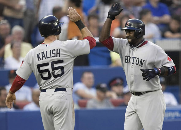 Red Sox second baseman Bill Hall, right, celebrates with Red Sox left fielder Ryan Kalish, left, after hitting a two run homerun against Toronto Blue Jays starting pitch Shaun Marcum during fourth inning of their baseball game in Toronto on Wednesday, Aug. 11, 2010.