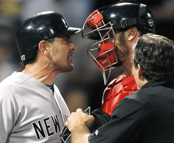 Francisco Cervelli, left, argues with Boston Red Sox catcher Jarrod Saltalamacchia after he was hit by a pitch from John Lackey during the seventh inning of a baseball game at Fenway Park