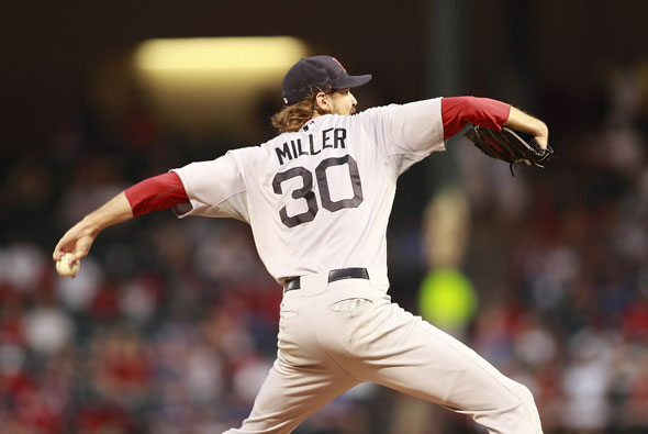 Miller throws a pitch against the Texas Rangers during the game at Rangers Ballpark in Arlington on August 25, 2011 in Arlington, Texas.