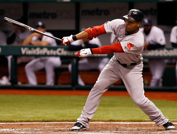 Carl Crawford of the Boston Red Sox fouls off a pitch against the Tampa Bay Rays during the game at Tropicana Field on June 14, 2011 in St. Petersburg, Florida