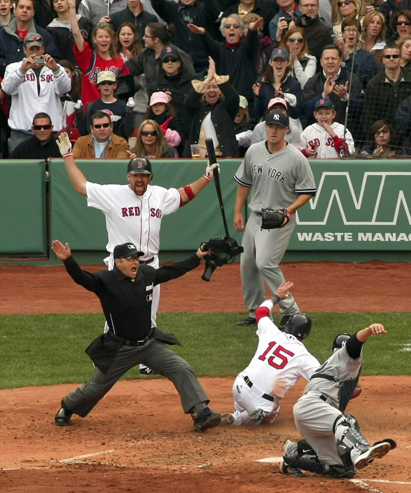 4/8/2011-Red Sox home opener-Sox vs Yankees .. In the 2nd inning, Dustin Pedroia slides in safely at home on a single by Sox Adrian Gonzalez past the tag of Yankees catcher Russell Martin. Umpire Mark Wegner made the call. Sox Kevin Youkillis (left rear) cheers.