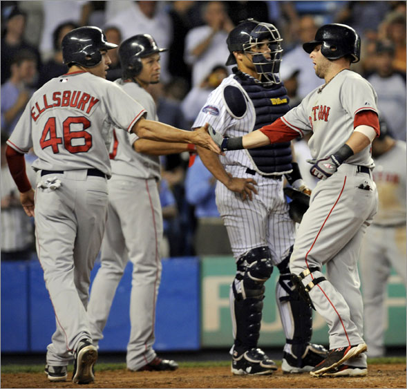 Dustin Pedroia (right) got congratulated by Jacoby Ellsbury and Coco Crisp at home plate after hitting a grand slam in the seventh inning Wednesday night.
