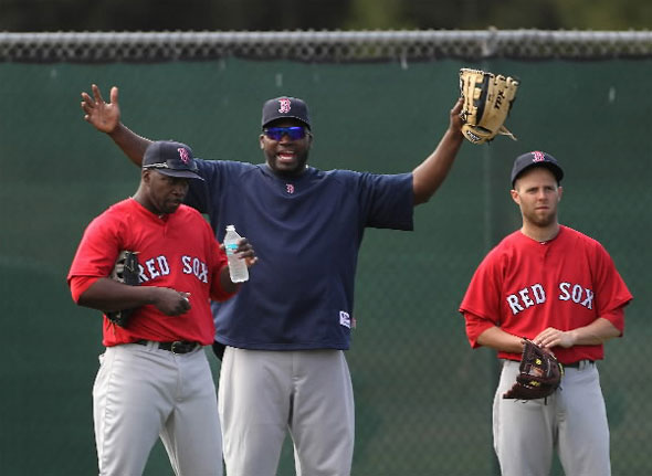 Boston Red Sox designated hitter David Ortiz, center, clowns around with from L to R: Bill Hall, and second baseman Dustin Pedroia