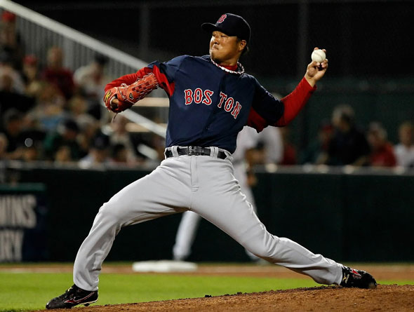 Pitcher Hideki Okajima of the Boston Red Sox pitches against the Minnesota Twins during a Grapefruit League Spring Training Game at Hammond Stadium on February 27, 2011 in Fort Myers, Florida.