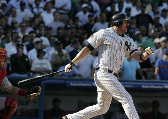 Jason Giambi follows through on a single to drive in the winning run in the ninth inning on Thursday afternoon.