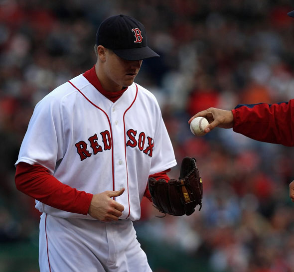 Boston Red Sox manager Terry Francona hands Red Sox relief pitcher Jonathan Papelbon the ball in the 8th inning. The Boston Red Sox play the LA Angels in Game 3 of the ALDS.