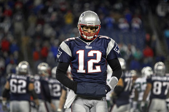 Patriots quarterback Tom Brady walks to the bench after his final play of ther season. The New England Patriots hosted the New York Jets in an NFL AFC Playoff Game at Gillette Stadium