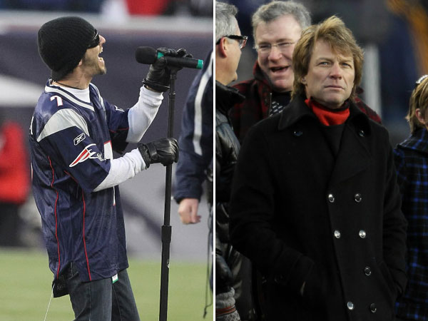 Lead singer of Godsmack Sully Erna sings the National Anthem at the New England Patriots game against New York Jets at Gillette Stadium. Bon Jovi stands on the sidelines.