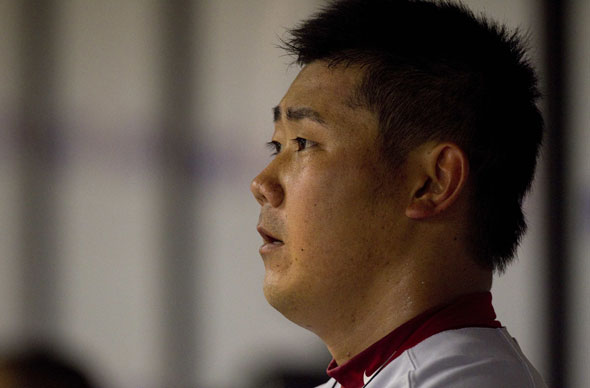 Daisuke Matsuzaka watches the game against the Tampa Bay Rays from the dugout during the third inning of their MLB American League baseball game in St. Petersburg