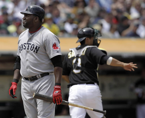 David Ortiz, left, reacts after striking out against the Oakland Athletics to end the top of the fifth inning of a baseball game in Oakland, Calif., Wednesday, July 21, 2010. Athletics' catcher Kurt Suzuki, right, looks on.