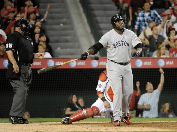 David Ortiz of the Boston Red Sox watches his two run homerun for a 4-1 lead over the Los Angeles Angels during the eighth inning at Angel Stadium on July 26, 2010 in Anaheim, California.
