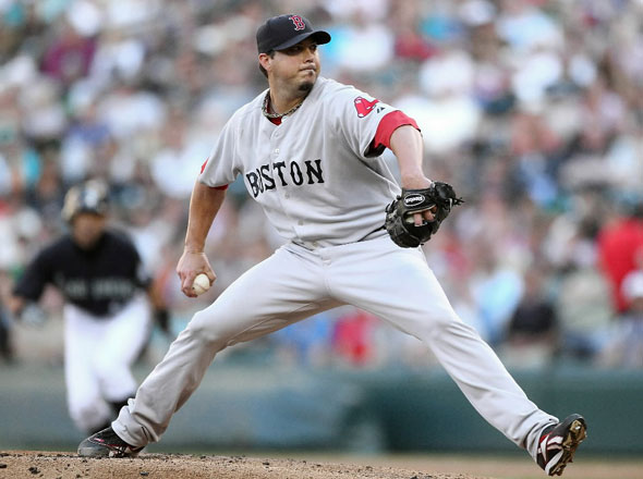Starting pitcher Josh Beckett #19 of the Boston Red Sox pitches against the Seattle Mariners at Safeco Field