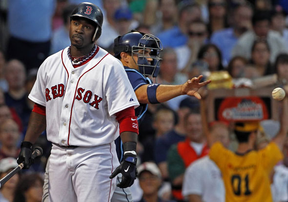 The Red Sox Bill Hall reacts after being called out on strikes to end the second inning. Rays catcher Kelly Shoppach heads for the dugout. The Boston Red Sox take on the Tampa Bay Rays at Fenway Park