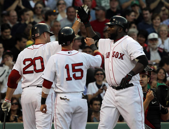 Boston Red Sox designated hitter David Ortiz is congratulated at the plate after hitting a 2 run HR in the 1st.